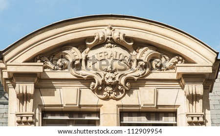 """Discipline sign on the top of the building of the University Sorbonne, """"mineralogy"""" - stock photo"""