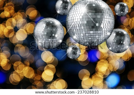 Disco ball and evening ornaments with lights  - stock photo