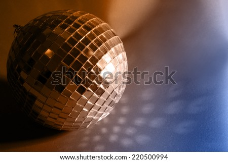 Disco ball on color background - stock photo