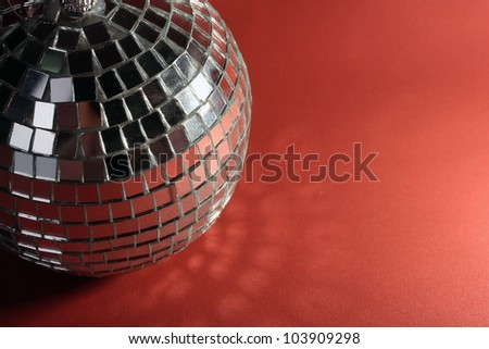 disco ball on red background - stock photo