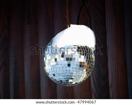 Disco ball  somewhere outdoor in the ski resort - stock photo
