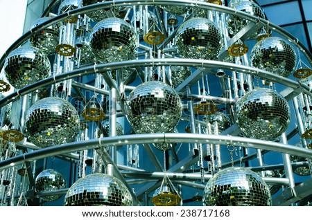 Disco balls background with mirror balls  / Disco balls/ Disco balls background with mirror balls. Outdoor view (disco, ball, shine)  - stock photo