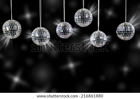disco balls with silver shining in front of black - stock photo
