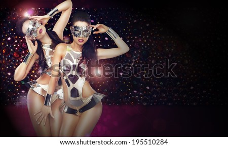 Disco Club. Women in Trendy Stagy Costumes Dancing over Abstract Background - stock photo
