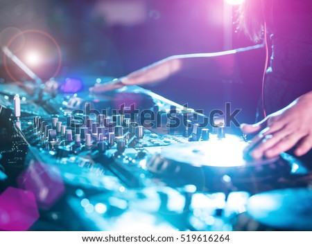 Disco DJ playing and mixing music. Nightlife in club.