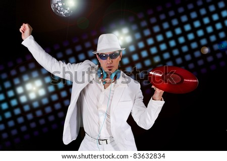 Disco DJ with Record and Club Lights in the background - stock photo