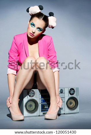Disco girl and tape recorder - stock photo