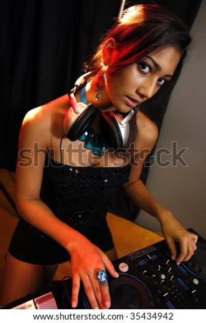 Disco karaoke teen, headset and turntable - stock photo