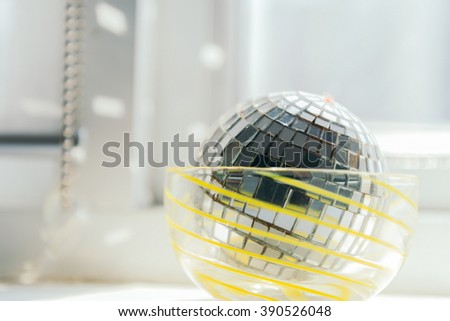 Disco Mirror Ball with light from window - stock photo