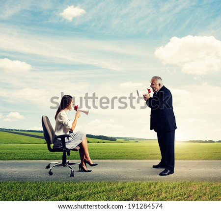 discontented young woman and emotional senior man at outdoor