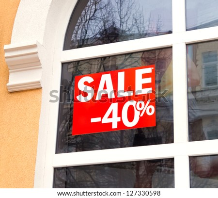 Discount sale sign in the window - stock photo