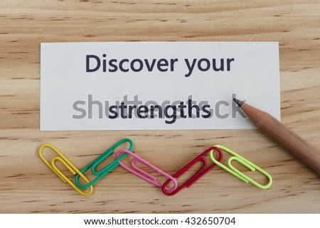 Discover your strengths- business concept of  entrepreneur management message on wood background with paper clips - stock photo