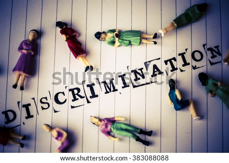 discrimination text on white paper with disabled people around - stock photo