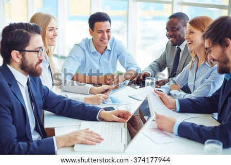 Discussing business plans - stock photo