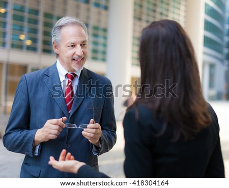 Discussion between business people - stock photo