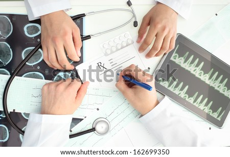Discussion between doctors. The situation in the hospital - stock photo