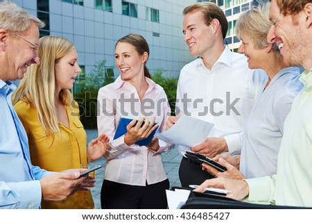 Discussion in a dynamic business team with tablet computer outdoors