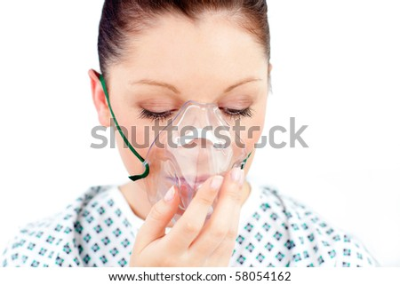 Diseased caucasian  woman wearing a mask against white background - stock photo