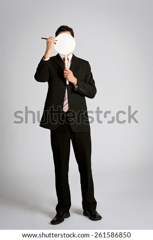 Disguise: Man Creating Mask For Himself - stock photo