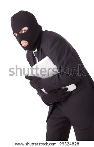 Disguised computer hacker - stock photo