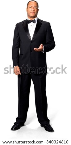 Disgusted African man with short black hair in evening outfit pointing using palm - Isolated