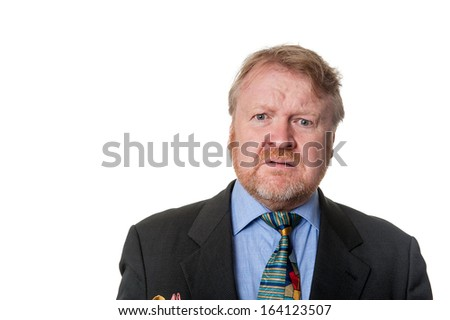 Disgusted bearded middle aged man in suit & tie, wincing, isolated on white