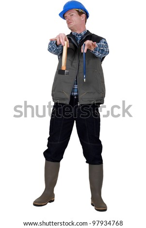 Disgusted builder holding hammer and chisel - stock photo
