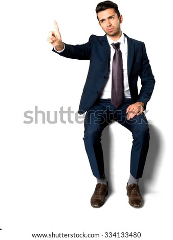 Disgusted Caucasian man with short dark brown hair in business formal outfit with hands on thighs - Isolated