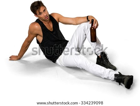 Disgusted Caucasian young man with short dark brown hair in casual outfit holding beer bottle - Isolated - stock photo