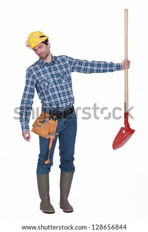Disgusted man holding shovel