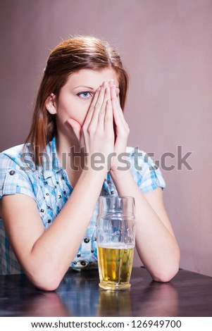 disgusting looking woman with a glass of beer