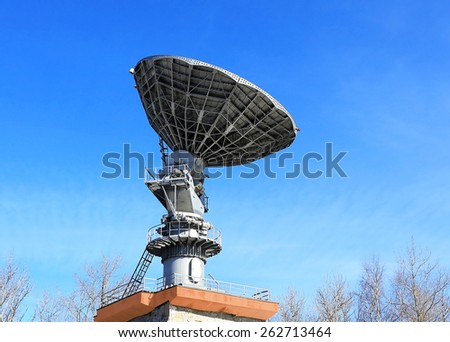 Dish antenna of mobile device satellite communication with a metallic reflector in operation - stock photo