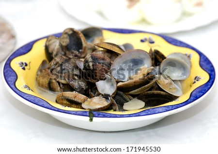Dish Clams cooked in sauce, served in a restaurant