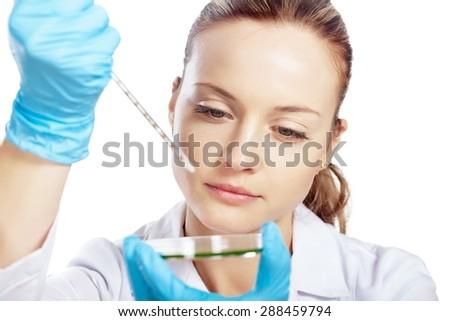 Dish, medical, dropper. - stock photo