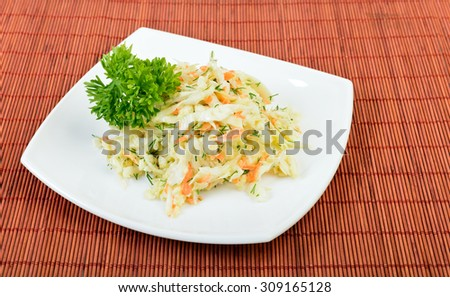 dish of coleslaw salad on table - stock photo