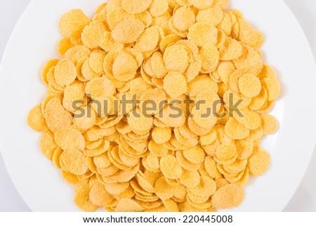 Dish of corn flakes - stock photo