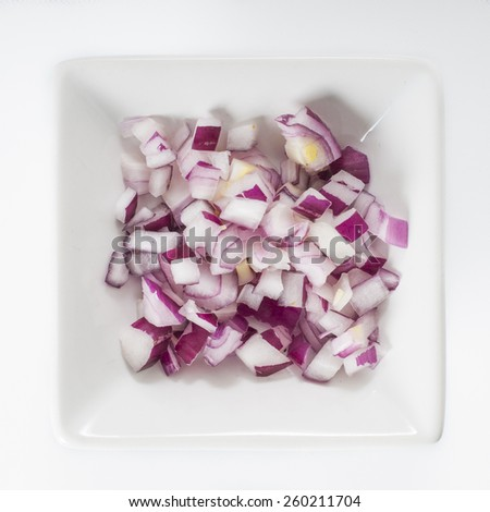 Dish of fine sliced smoked salmon lox and purple onions - stock photo