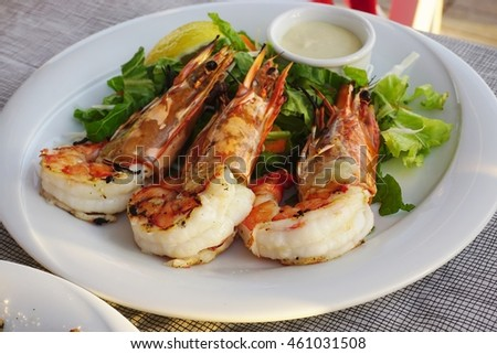 Dish of grilled shrimp with head on