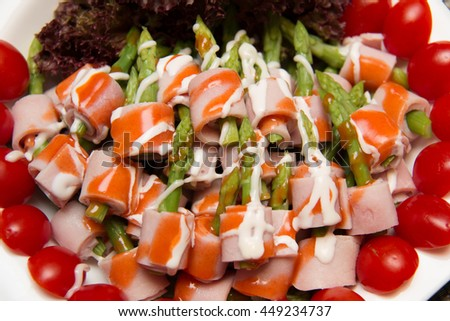 Dish of Ham and Asparagus Salad on white dish