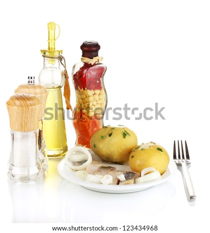 Dish of herring and potatoes on plate isolated on white