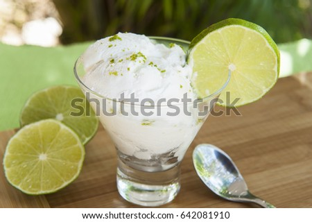 Dish of lime ice cream with lime slices served outdoors