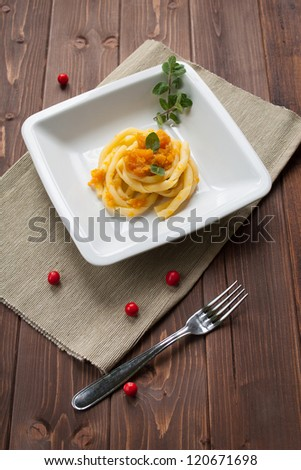 Dish of pasta with pumpkin for vegetarian meal - stock photo