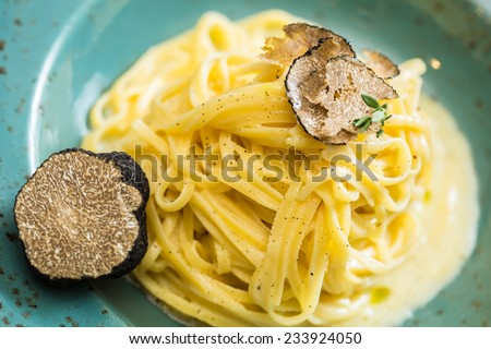 Dish of pasta with truffle. selective focus. close-up - stock photo