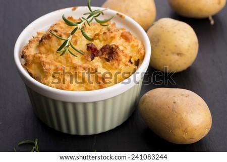 dish of potato souffle with rosemary - stock photo