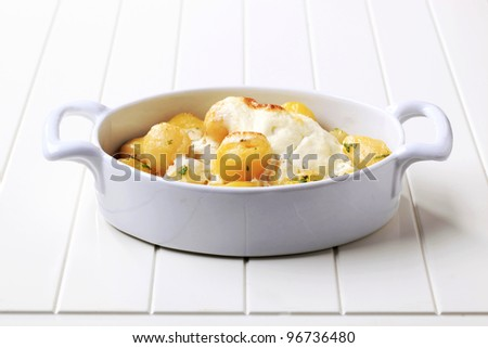 Dish of potatoes with sour cream  - stock photo