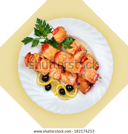 Dish of salmon fish on skewer on white plate. Isolated image with white bckground. View from above. still life of setout table Russian cuisine