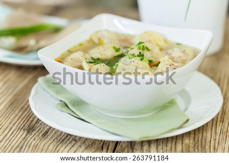Dish of savory tortellini pasta filled with pork in a tasty broth seasoned with fresh herbs and served for dinner
