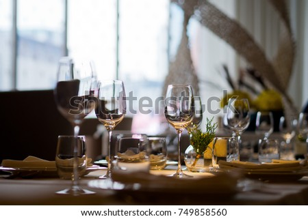 dish spoon fork on table at restaurant . wine glass