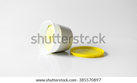 Dish-washing paste for washing dishes or other kitchen tools. Isolated on empty background. Slightly de-focused and close-up shot. Copy space.