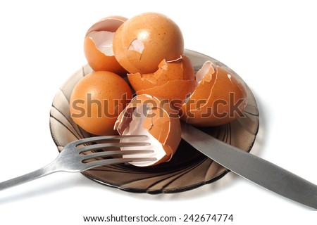 Dish with empty egg shells, healthy calcium source - stock photo